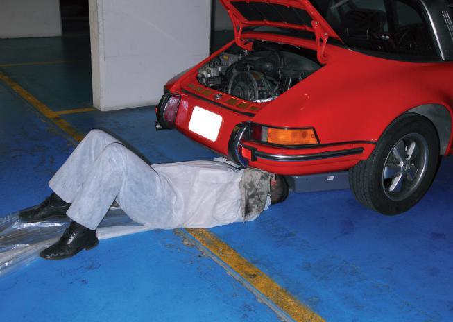 vidange d'une Porsche 911 rouge